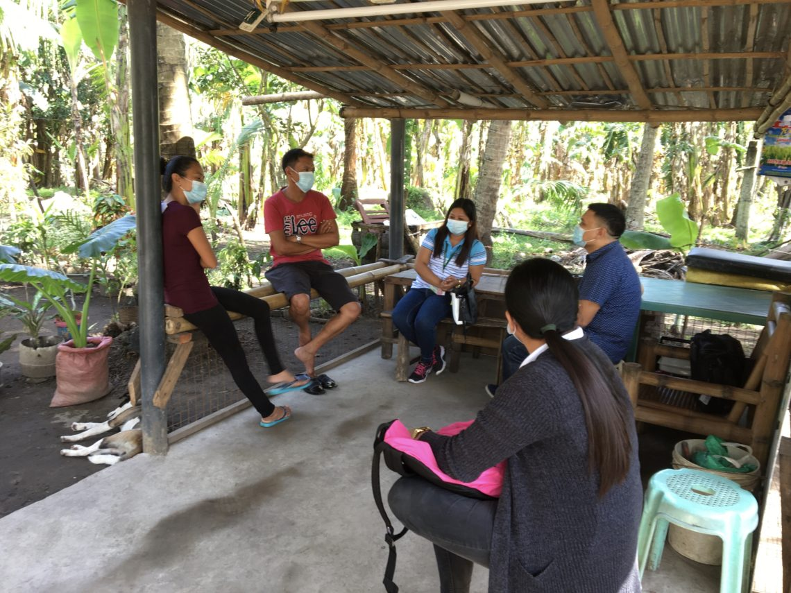 Local F2F partner AJ Rodriguez meets in an open-air structure with ASHI members.