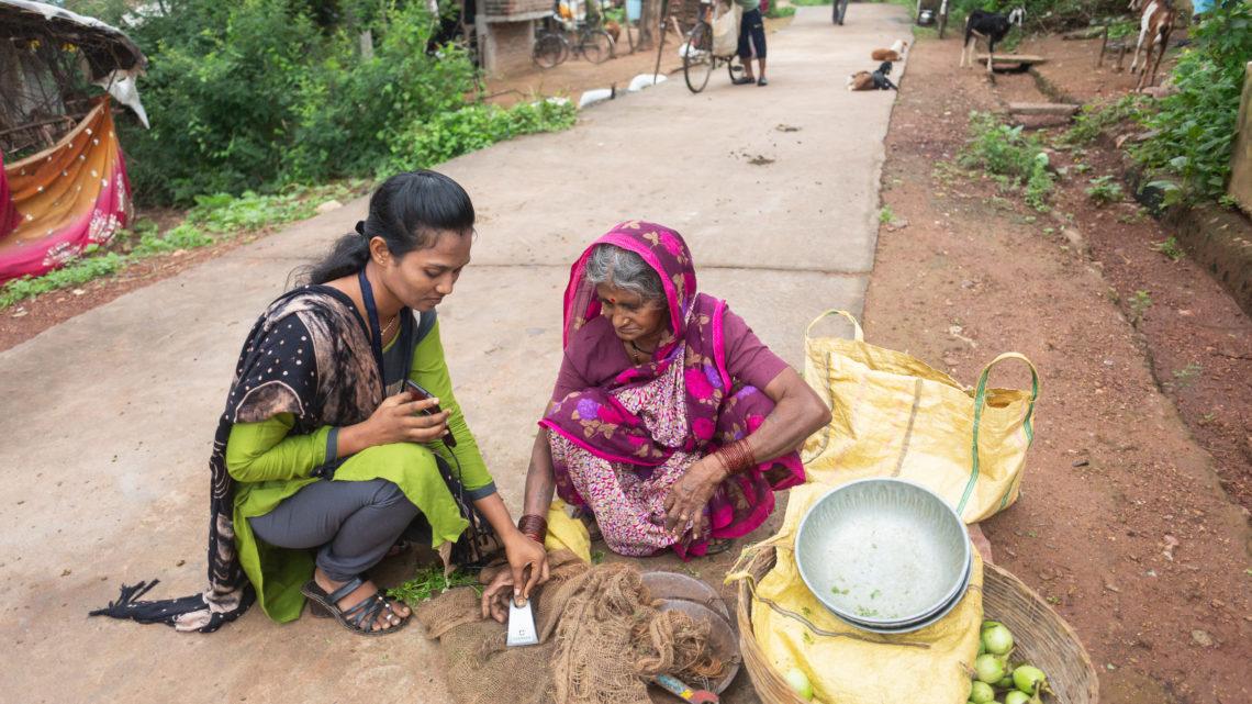 Mittra helping customer in street