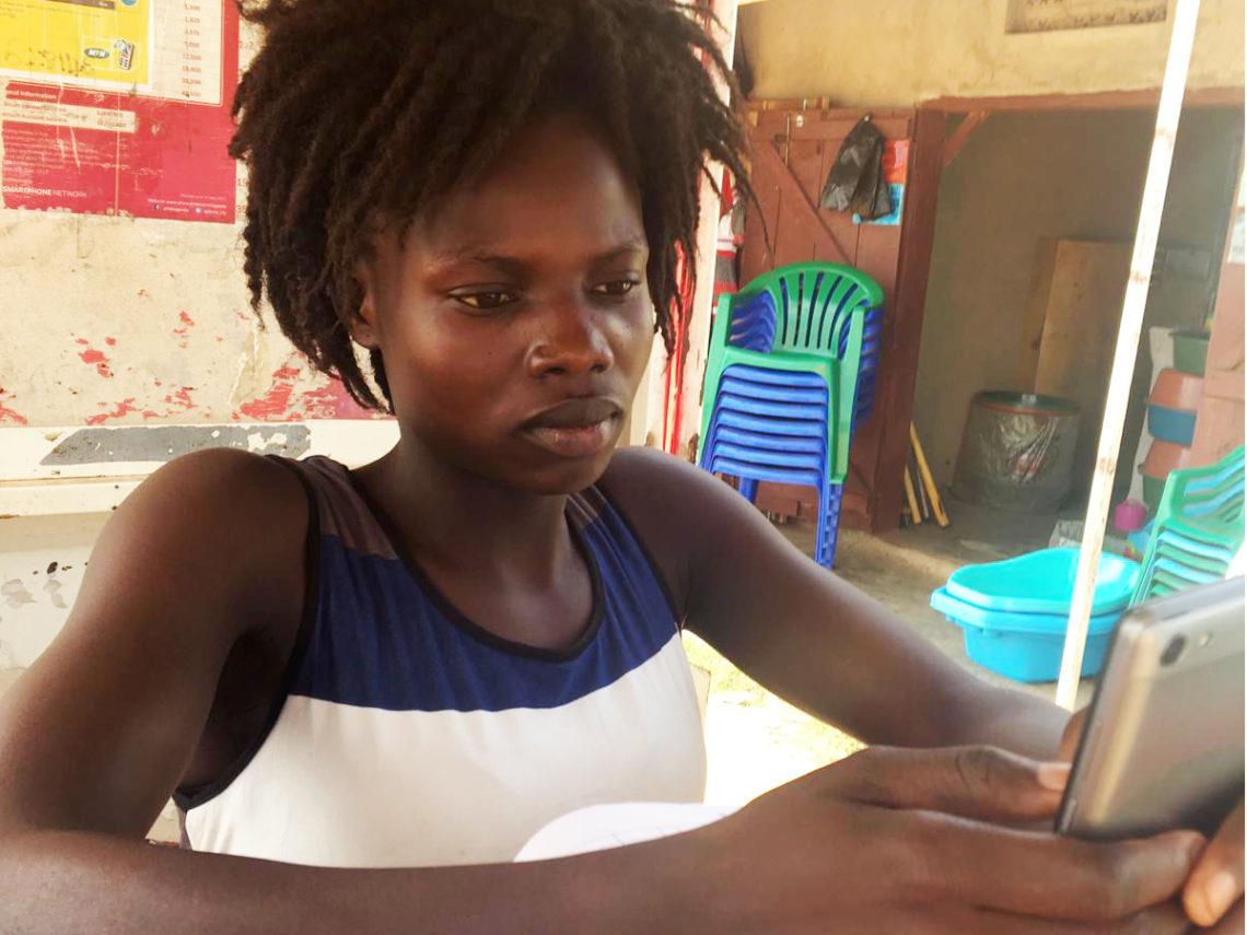 Bidi Bidi refuge on her phone
