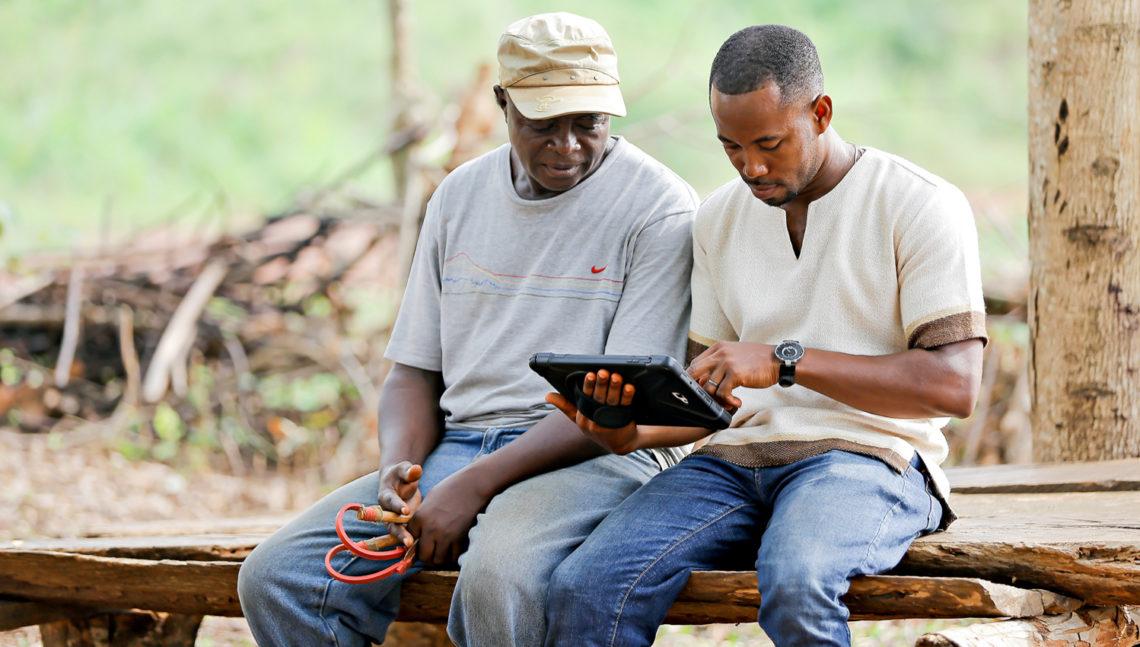Farmer working with Grameen Digital Farming Agent