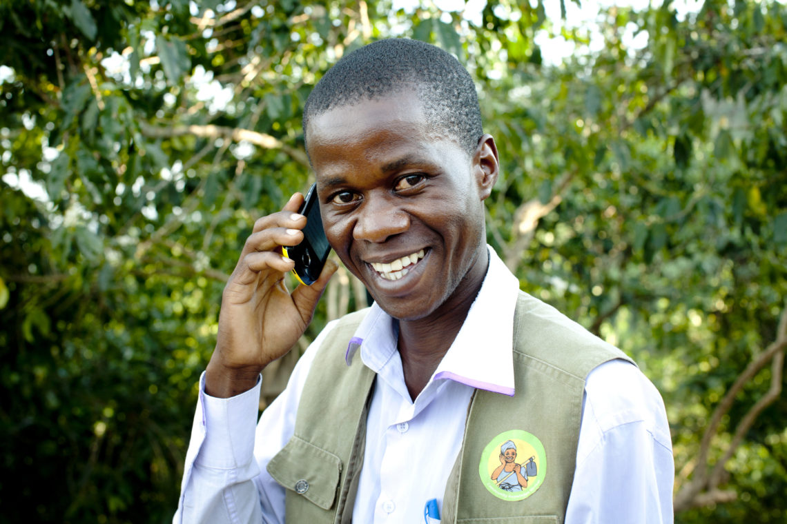 Community Agent on phone smiling