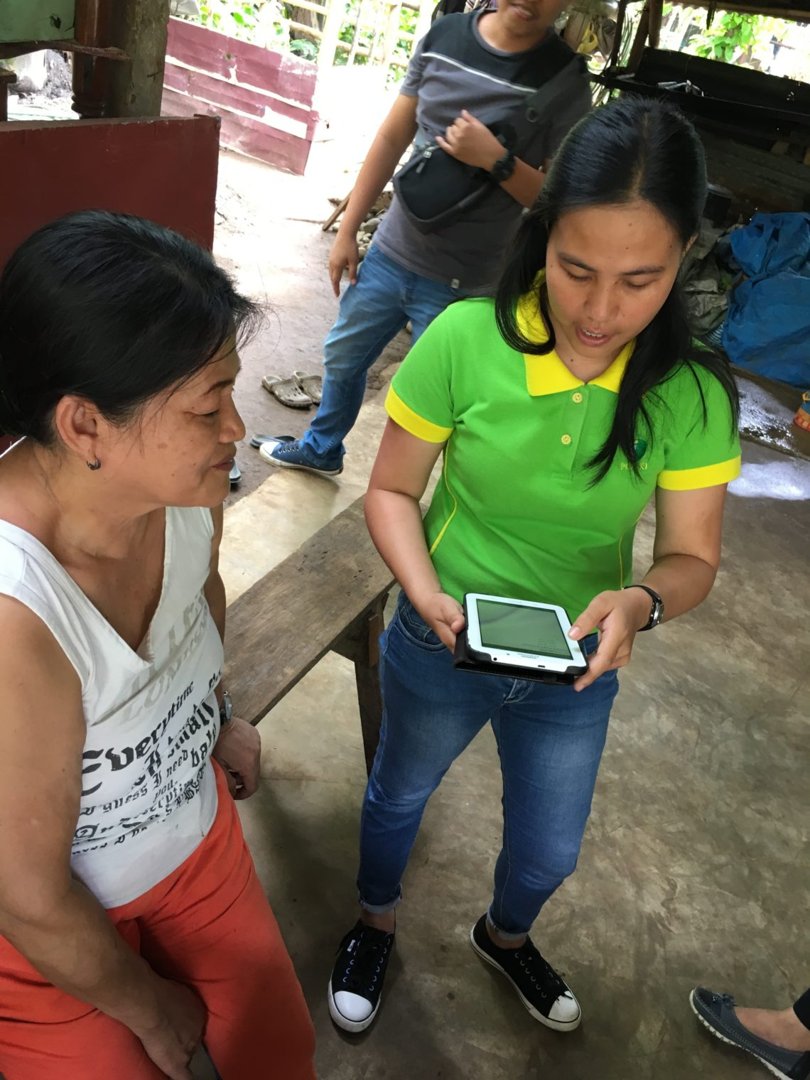 agent and client looking at tablet