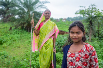 Indian woman and daughter strong and proud working in field