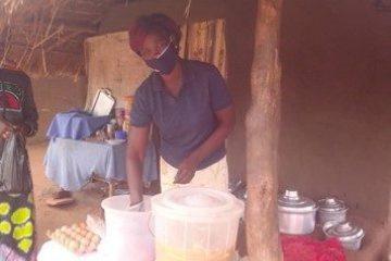 Mary Sadia works at her new restaurant in Bidi Bidi refugee camp