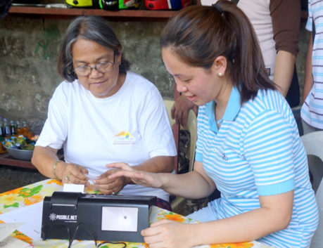 Grameen Community Agents doing digital financial transaction