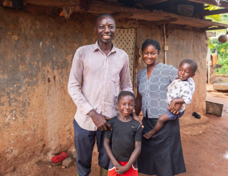 Smiling farmer with his family