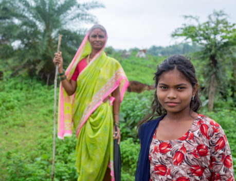 Indian woman and daughter in field